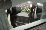 The grandsons lead the casket into the hearse from the church on the way to the cemetery. Harold...