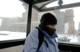 (DENVER, Colo., Feb. 16, 2005)  A cold Aiyana Titus (cq) of Denver, waits for her bus and Broadway...
