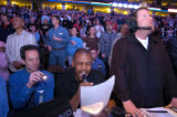Kyle Speller (cq), center announces the Denver Nuggets players  at pre-game while Altitude TV's...