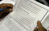 Kyle Speller (cq) marks a page of his script before the Denver Nuggets/Chicago Bulls game at the...