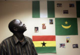 Southern Sudanese refugee Kur Kur looks at the flag in the African Student Association Office on...