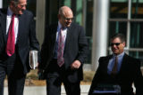 Former Qwest executive vice president Marc Weisberg, center, leaves the Federal Courthouse Friday,...