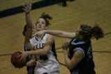 In the 4th period, Mullen's #4 Jamie Maynard goes up for the basket fighting to stop her is...