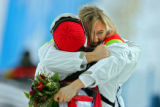 Gold medal winner Tanja Frieden of Switzerland gets a hug from one of her coaches after winning...