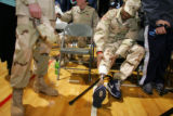 Sergeant Leroy Scott, cq, a member of 2/3 Armored Cavalry Regiment, adjusts his prosthetic leg...