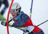 Lindsey Kildow crashes through a gate on her first slalom run in the women's combined downhill in...