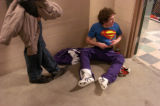 Arvada West's Ron Sanchez puts his Superman shirt on in the hallway of the Pepsi Center after...