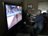 Louisville, CO Feb, 17, 2006 Scott Brown, president of NetDevil, views characters from his...