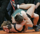 Gunnison's Levi Tredway, bottom, is held down by Monte Vista's Kyle Francis, top,  in semifinal...