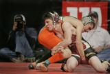Ponderosa High School's Ty Bennet, left, wrestles Adams City High School's A.J. Maestas, right, in...