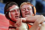 Tanner Ridgway, left, of Paonia High School holds down Tanner Kern, right, of  Cheywell High...