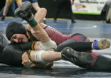 Brooke Sauer, right,  a senior at out of Golden High School wrestles Sean Ender of Thompson Valley...