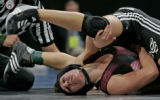 Brooke Sauer, bottom, a senior at out of Golden High School wrestles Jeremy Aguero, right,  of...