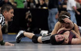 Brooke Sauer, bottom, a senior at out of Golden High School wrestles Jeremy Aguero , top,  of...