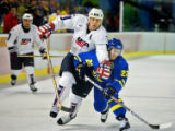 Team U.S.A.'s Keith Tkachuk (#7) tries to get past Team Sweden's Per Johan Axelsson (#22) during...