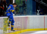 Former Avalanche player and Team Sweden's Peter Forsberg jumps over the boards after the second...