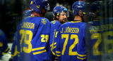 Former Avalanche player and current Team Sweden forward Peter Forsberg (center) leaves the ice...