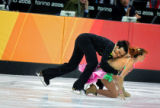 Italian figure skating couple Marurizio Margaglio (left) and Barbara Fusar Poli (right) fall...