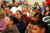 Audience members listen to a question regarding the theft of a laptop at Metro State College of...