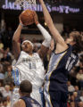 Denver Nuggets forward Carmelo Anthony, left, shoots over Memphis Grizzlies forward Pau Gasol,...