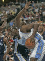 Denver Nuggets forward Reggie Evans, bottom, goes up for a shot being defended by Memphis...