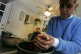 Rosalia Hernandez, cq, 42, prepares pinto beans with her husband Samuel Hernandez, cq, 47, in...