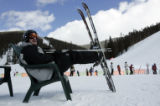 Dave Coffin (cq) from Colorado Springs, kicks up his heels as he takes a break from skiing at the...