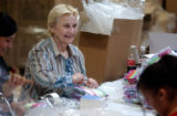Sharon Zolman (cq) ,center, packages baby sock products at Goldbug, an Aurora- based  business on...