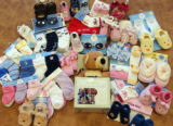 Baby sock products sold by Goldbug, an Aurora- based  business on Monday March, 6,2006. Goldbug is...