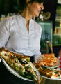 Dining Guide.  Melba Dardano (cq) serves up some hearty italian food to diners at Vincenza's...