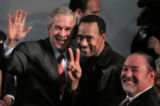 JPM450  President George W. Bush, left, waves as he poses with Darin Smith, 41, of Aurora,  for a...