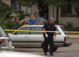 Denver, Colo., photo taken June 17, 2004- Glendale police investigator looks for a reported...