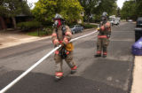 Denver, Colo., photo taken June 17, 2004-  Denver fire fighters Mike Somma (left)  and Nick Kroski...