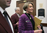 Surrounded by four security guards, Senator Deanna Hanna (D) SD 21 leaves her last committee...