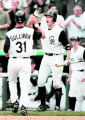 Rockies SS Clint Barmes high fives Rockies OF Cory Sullivan   (cq roster)  after Sullivan scored...