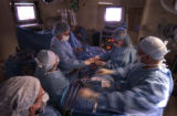 (BACKGROUND FAR LT.) Doctor Warren Kortz (CQ) removes a kidney living donor Dana Derichsweiler, of...