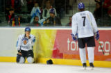 Finland's Teemu Selanne (#8), a former Avalanche player, sits in the corner after getting a stick...