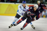 Former Avalanche player and current Team U.S.A. player Chris Drury (#18) reaches for an airborne...