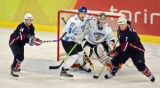 Finland's goaltender Antero Niittymaki (#31) tries to see the action between teammate Teppo...