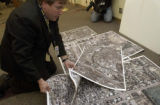 John Leavitt, (cq), Senior Public Communications Specialist, sorts aerial perspective images for...