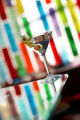 Dining Guide.  A martini against the backdrop of the colorful glass wall at Cafe Star at 3201 E....