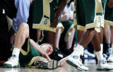 Colorado State guard Andrew Patterson tries to pick himself up after hitting a pick in the first...