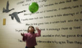 Brittany Omana (with tilda) plays with a balloon in the hallway at Maria Mitchell Elementary...