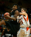 Harrison's Antoine Watson (#11, in black) pulls down a rebound in front of Greeley Central's Ryan...