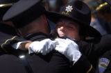 (7/2/2004, Ft. Collins, CO.)    The memorial service for Deputy Sheriff Travis Wayne Sass, killed...