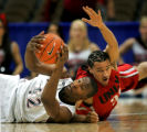 UNLV's Curtis Terry (#31, right) dives for control of a loose ball with San Diego State's Marcus...