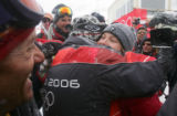 Julia Mancuso, of the USA, right, gets a hug from a supporter after winning the gold medal in the...