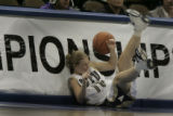 BYU player #10 Laura Stratton trips and ploughs into the championship sign in the first period. ...