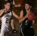 *****for file**** Bear Creek guard Aromous Robinson, right, is defended by Arapahoe's Jason Jones,...