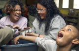 L to R: Fifth grade Fairview Elementary school students Yvonne Pham (cq), Simone Jackson(cq) and...